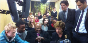 Desmond Tutu and Neelie Kroes play the game