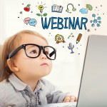 Webinar concept with toddler girl using her laptop